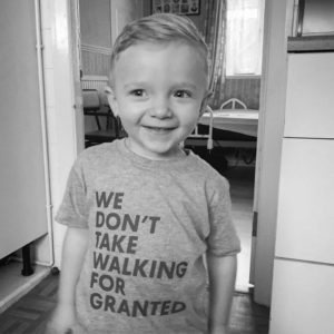 Oscar in 'We don't take walking for granted' t-shirt